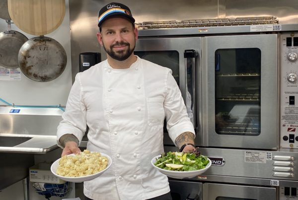 Chef Gerard Craft displays the pasta and salad dishes he created.