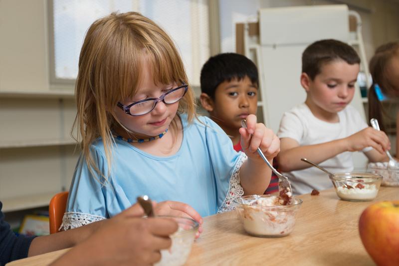 Children enjoying a bowl of yogurt