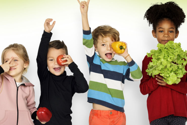 Children posing with vegetables