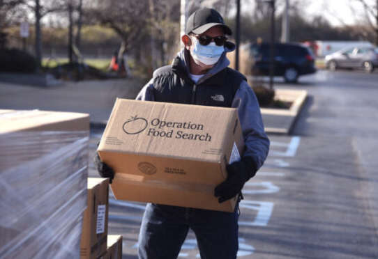 Employee delivering food to Operation Food Search Headquarters