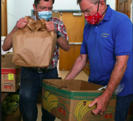 Volunteers donating food to Operation Food Search