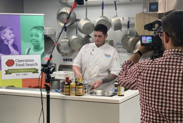 Chef prepares a meal in front of a video camera